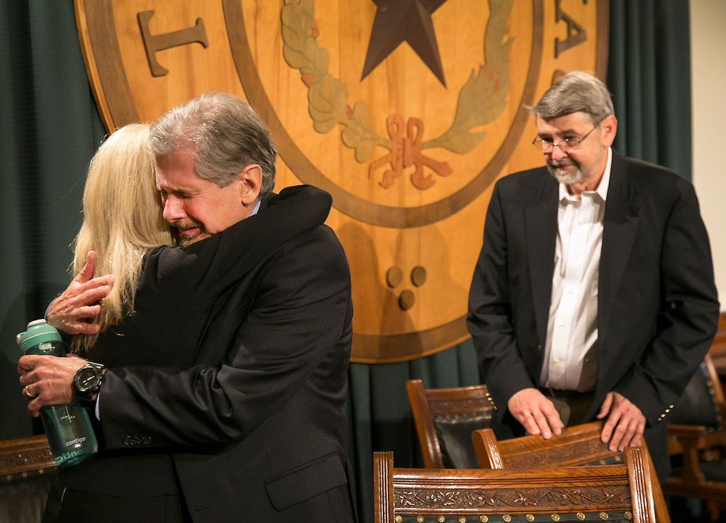 Kent Whitaker embraces his wife Tanya as his brother Keith Whitaker waits in support at back right, after reacting to the his lawyer Keith Hampton reading an email from the Texas Board of Pardons and Paroles,  which voted unanimously to recommend clemency for death row inmate Thomas Whitaker, Kent's son, who was found guilty of setting up an ambush that killed his mother and brother in 2003.