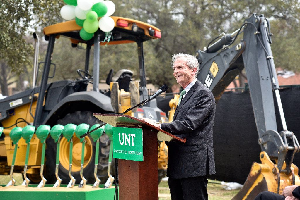 University of North Texas Chancellor Lee Jackson speaks to the crowd gathered for the ground breaking for a new resident hall.