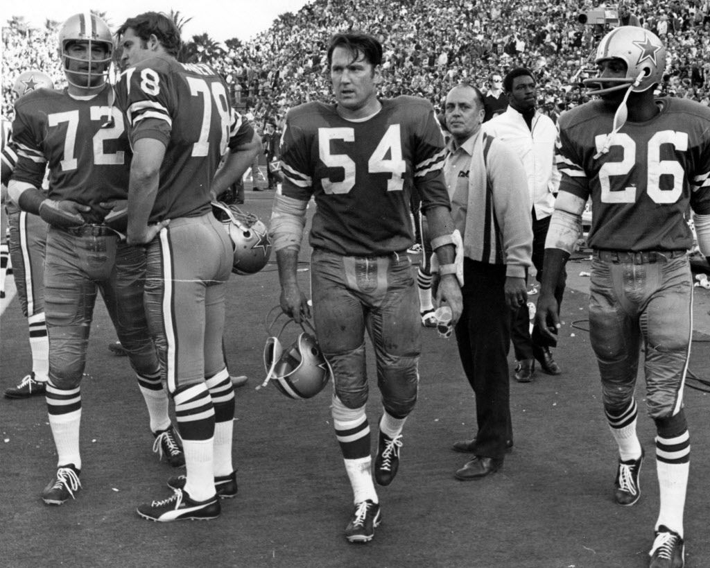 At Super Bowl V, played on Jan. 17, 1971, in Miami, the blue-jersey-wearing Dallas Cowboys lost to the Baltimore Colts. Shown here, from left to right, are blue-jersey-wearing Cowboys Tony Liscio (72), Bob Asher (78), Chuck Howley (54) and Herb Adderley (26).