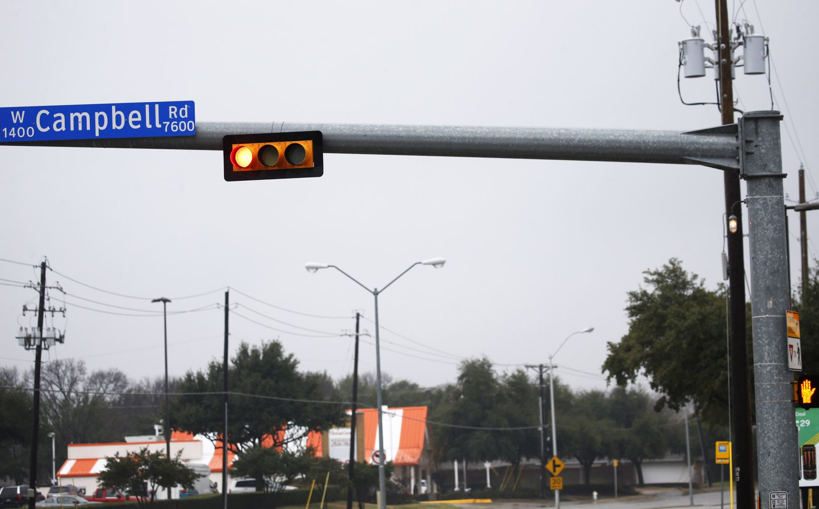 Richardson pioneered use of the white indicators (shown upper right on this traffic arm at Campbell and Coit roads) three decades ago. Installation was relatively inexpensive, at about $500 an intersection.