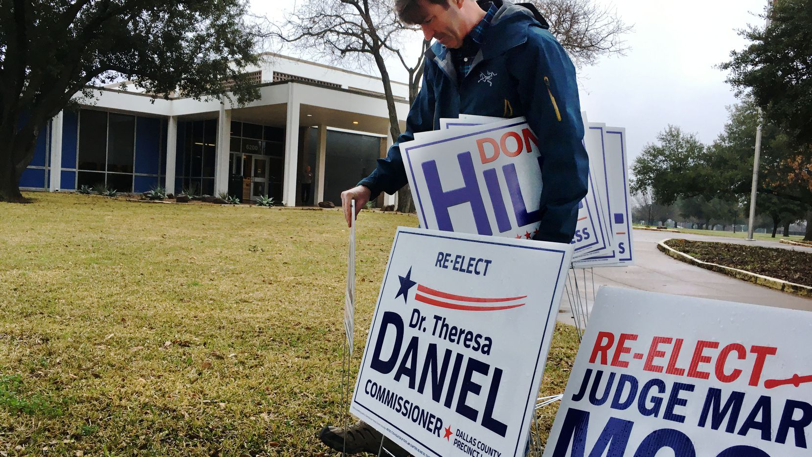 Don Hill, a Republican running for election in Texas' 5th Congressional District of the U.S. House of Representatives, puts out signs for himself at the Samuell Grand Recreation Center early voting location on Feb. 18, the first day of Democratic and Republican primary voting for the 2020 elections.