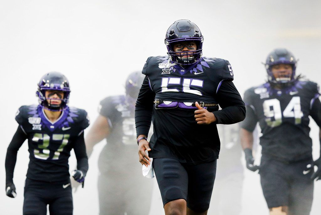 TCU Horned Frogs center Kellton Hollins (55) and the rest of his teammates run onto the field to face West Virginia Mountaineers at Amon G. Carter Stadium in Fort Worth, Friday, November 29, 2019.