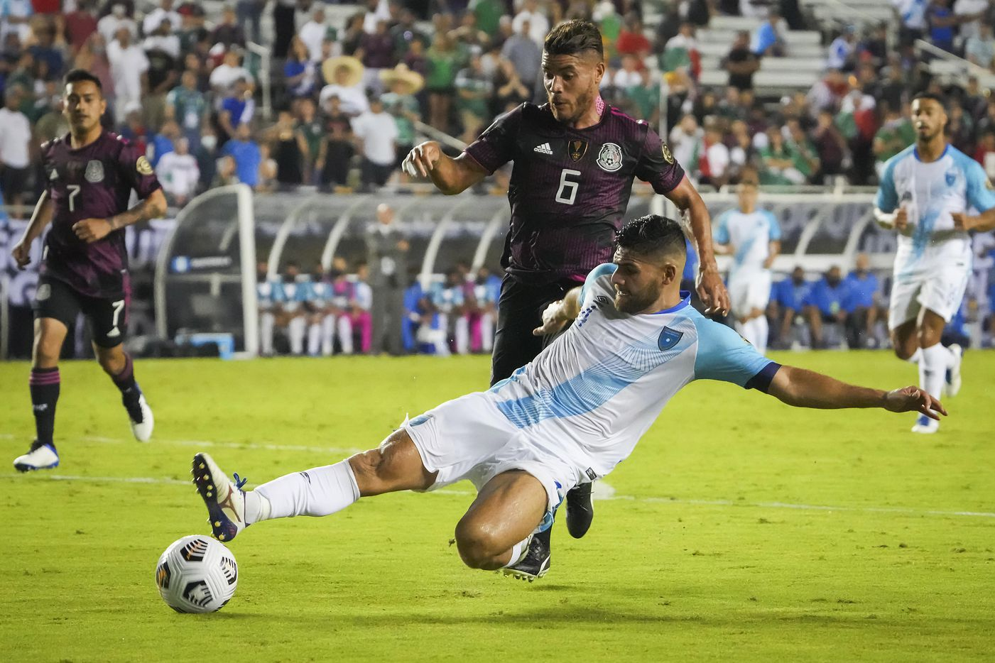 Guatemala defender José Pinto (4) knocks the ball away from Mexico midfielder Jonathan dos Santos (6) during the second half of a CONCACAF Gold Cup Group A soccer match at the Cotton Bowl on Wednesday, July 14, 2021, in Dallas.