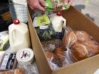 A farm box food order from Profound Foods, at a pickup location outside Community Beer Co. brewery in Dallas, May 07, 2020. The farm box contains artisan produce, meats and dairy. Ben Torres/Special Contributor