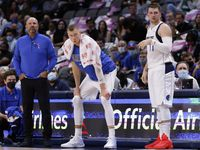 Dallas Mavericks center Kristaps Porzingis (center) reacts to a Mavs play against the Utah Jazz as head coach Jason Kidd and Luka Doncic (77) watch as well at the American Airlines Center in Dallas, Wednesday, October 6, 2021.