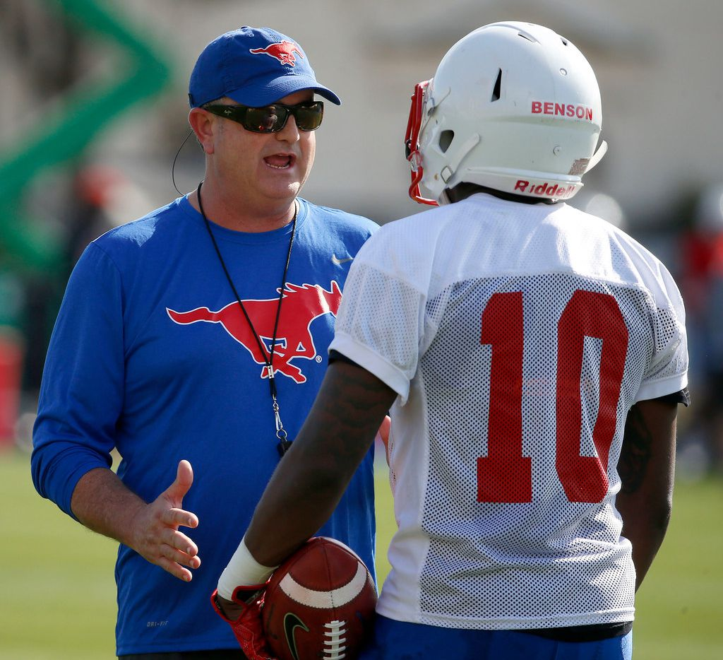 SMU head football coach Sonny Dykes, left, talks with wide receiver Brandon Benson during the first spring practice of the season on the campus in Dallas, Wednesday, March 21, 2018. (Jae S. Lee/The Dallas Morning News)