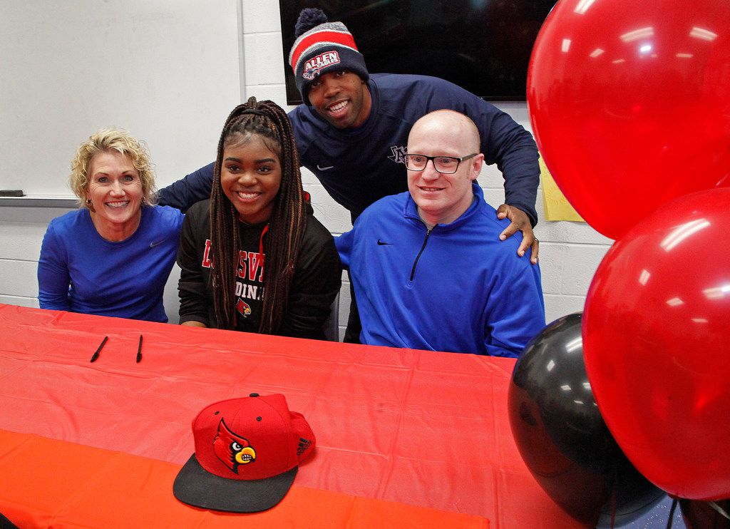 Allen High School student Nyah Green signed her letter of intent to play basketball for Louisville Wednesday morning, November 14, 2018. Posing for pictures with her were girls head basketball coach Teresa Durham (left), varsity assistant Gary Trombley (right) and JV coach Eron Sauls (top). (Stewart F. House/Special Contributor)