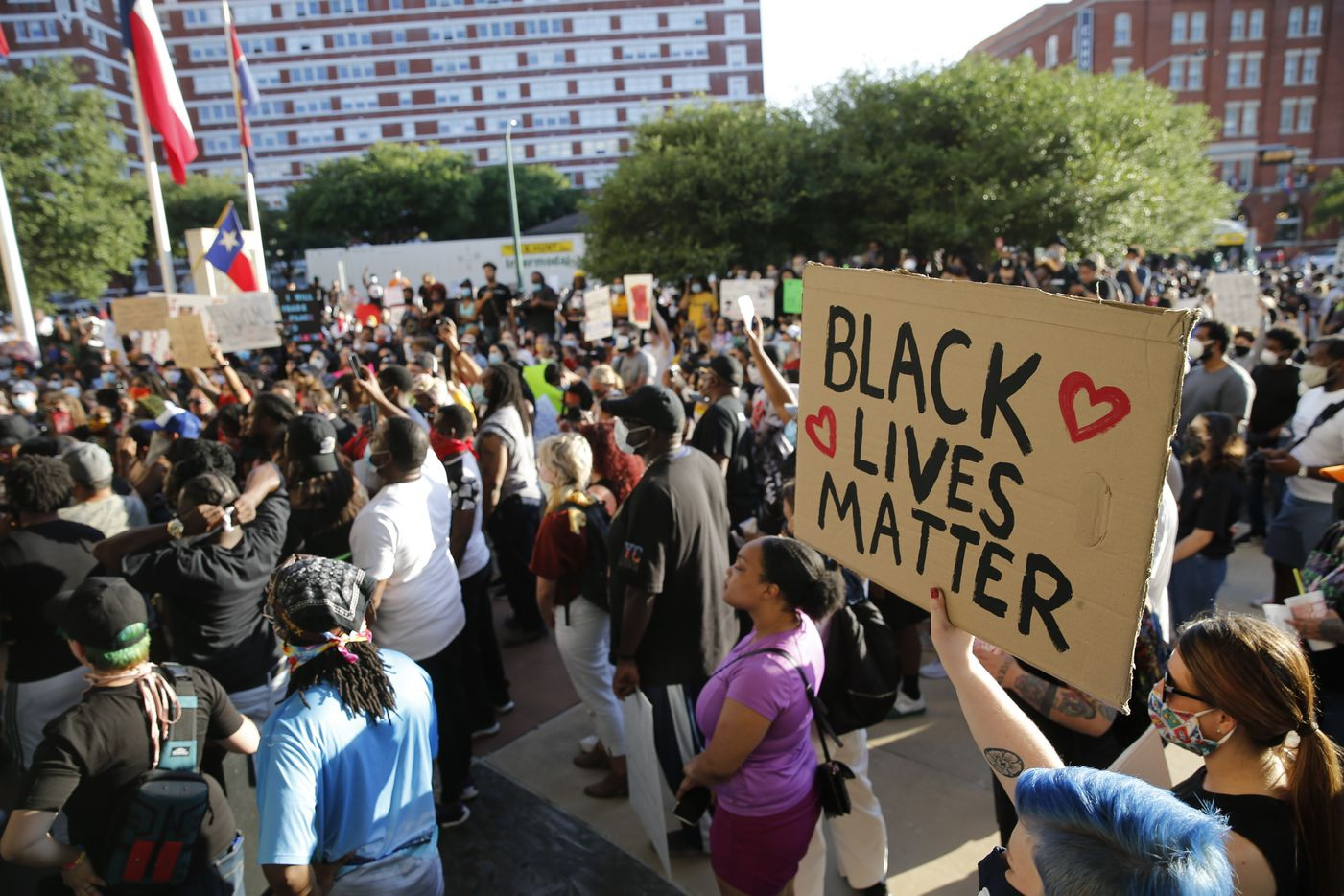 Protesters rally Friday during a demonstration against police brutality near downtown Dallas. The death of George Floyd police custody May 25 in Minneapolis has sparked protests nationwide.