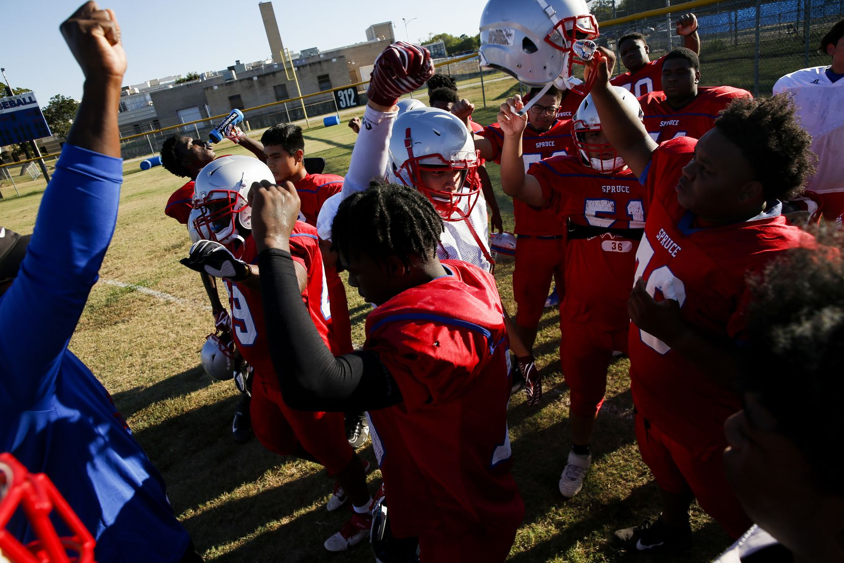 Spruce High School football players break out of huddle during football practice on Wednesday, Sept. 22, 2021, at H. Grady Spruce High School in Dallas. (Juan Figueroa/The Dallas Morning News)