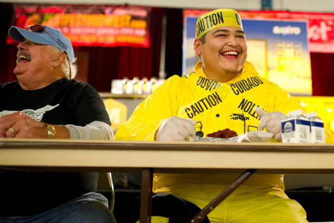 """Gino Lopez digs in during WingStop's """"atomic"""" wing-eating contest at ZestFest in 2019."""