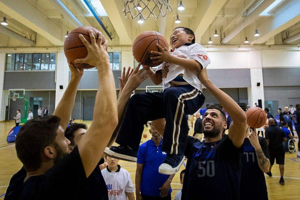 Dallas Mavericks center Salah Mejri (50) lifts a Special Olympian so he can dunk the ball into the basket during an NBA Cares event at the Oriental Sports Center on Thursday, Oct. 4, 2018, in Shanghai. The Mavericks will face the Philadelphia 76ers in Shanghai on Oct. 5th in the first of two NBA China Games 2018 preseason basketball games. (Smiley N. Pool/The Dallas Morning News)