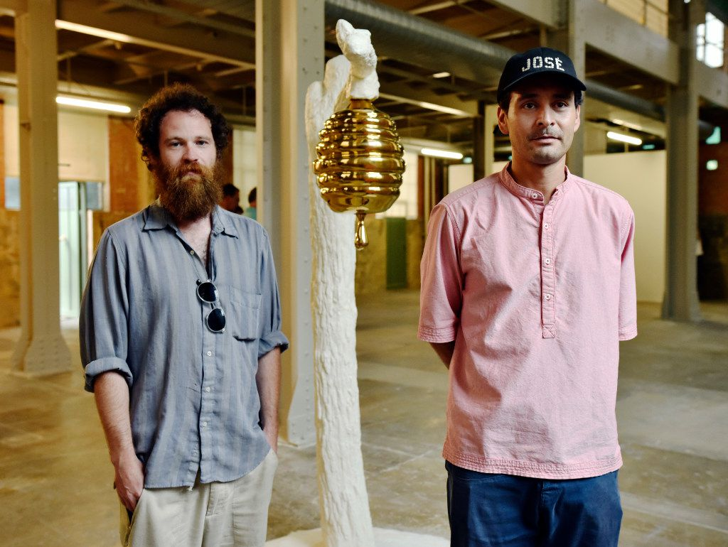 Artists Jeff Gibbons (left) and Gabriel Rico with Rico's Crudelitatem (I will say the romans that spread upon the world but it was the world that spread upon the romans)  during the opening of their show  at the Power Station in Dallas. Ben Torres/Special Contributor
