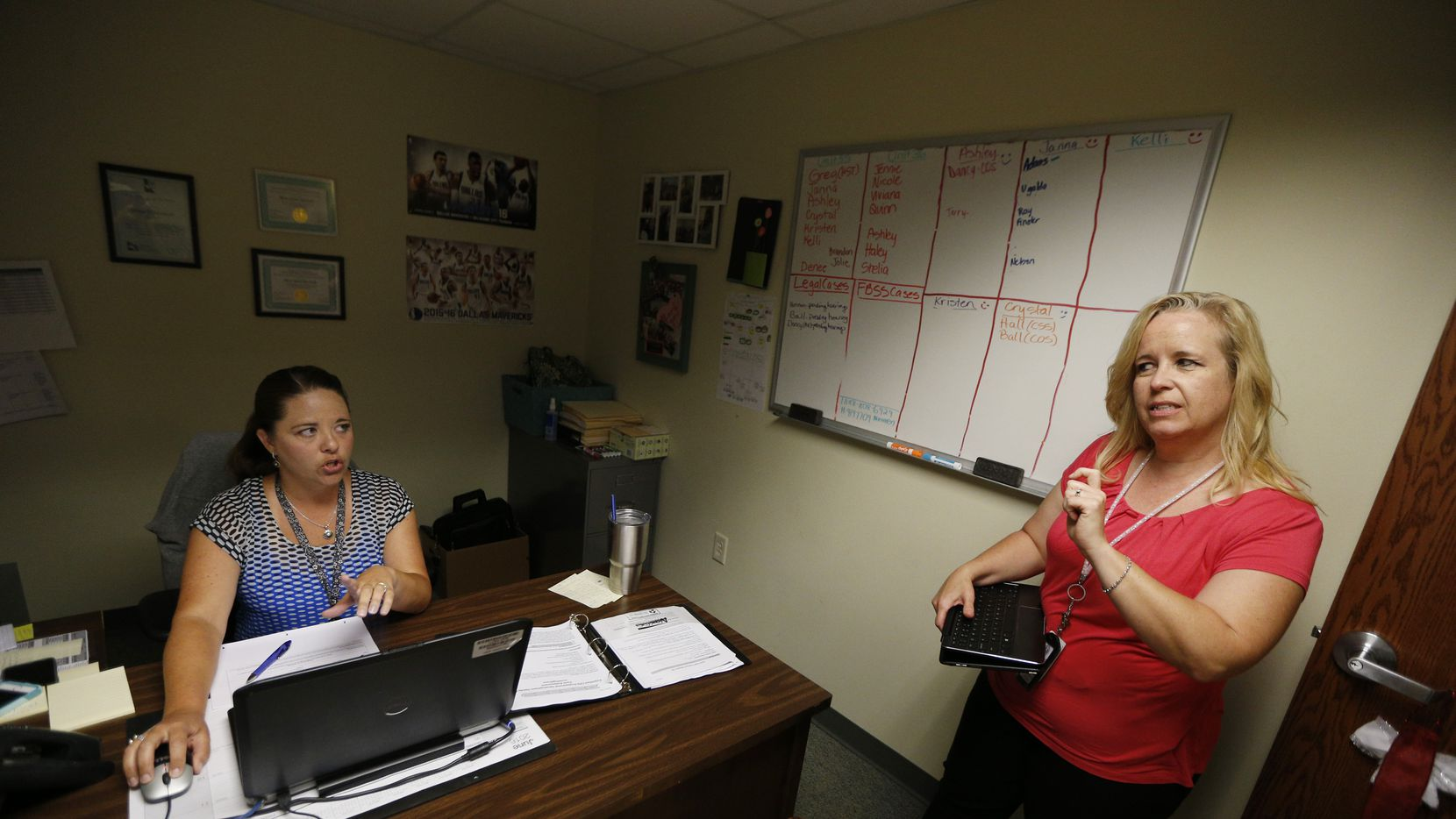 Tarrant County CPS investigator Kelli Bailey (right) talks to her supervisor, Denee Borchardt, about a new case in June 2016 in Fort Worth.  (Nathan Hunsinger/Staff Photographer)