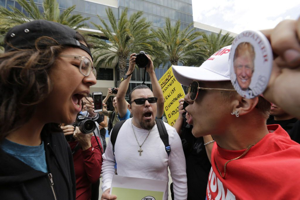 Donald Trump supporter Jake Towe (right) faces off with anti-Trump protester Joshua Gonzalez outside the Anaheim Convention Center in California during a Trump rally in May.