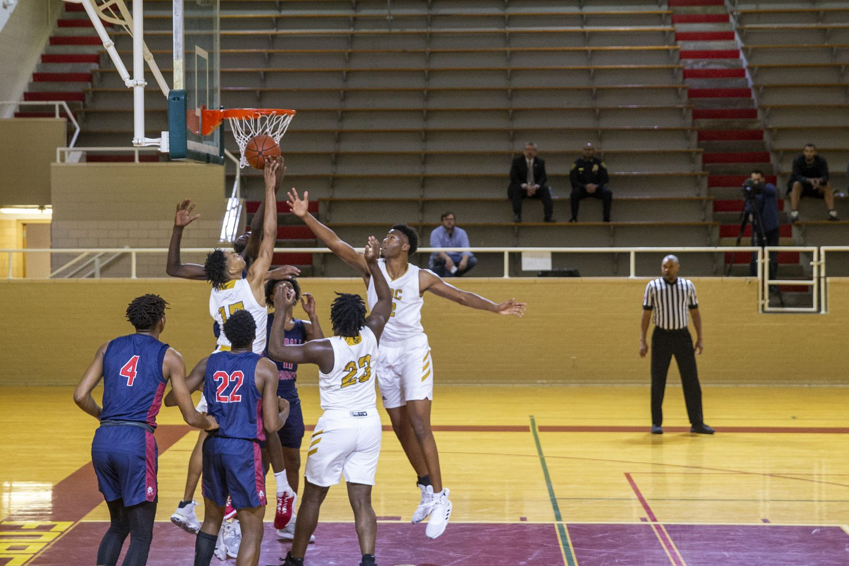 The resumption of the boys basketball game between South Oak Cliff and Kimball plays out before a sparse audience inside the Herschel Forester Field House in Dallas on Monday, Jan. 13, 2020. The game was suspended Saturday because of a shooting, and only a select few guests were allowed to attend the resumed game.