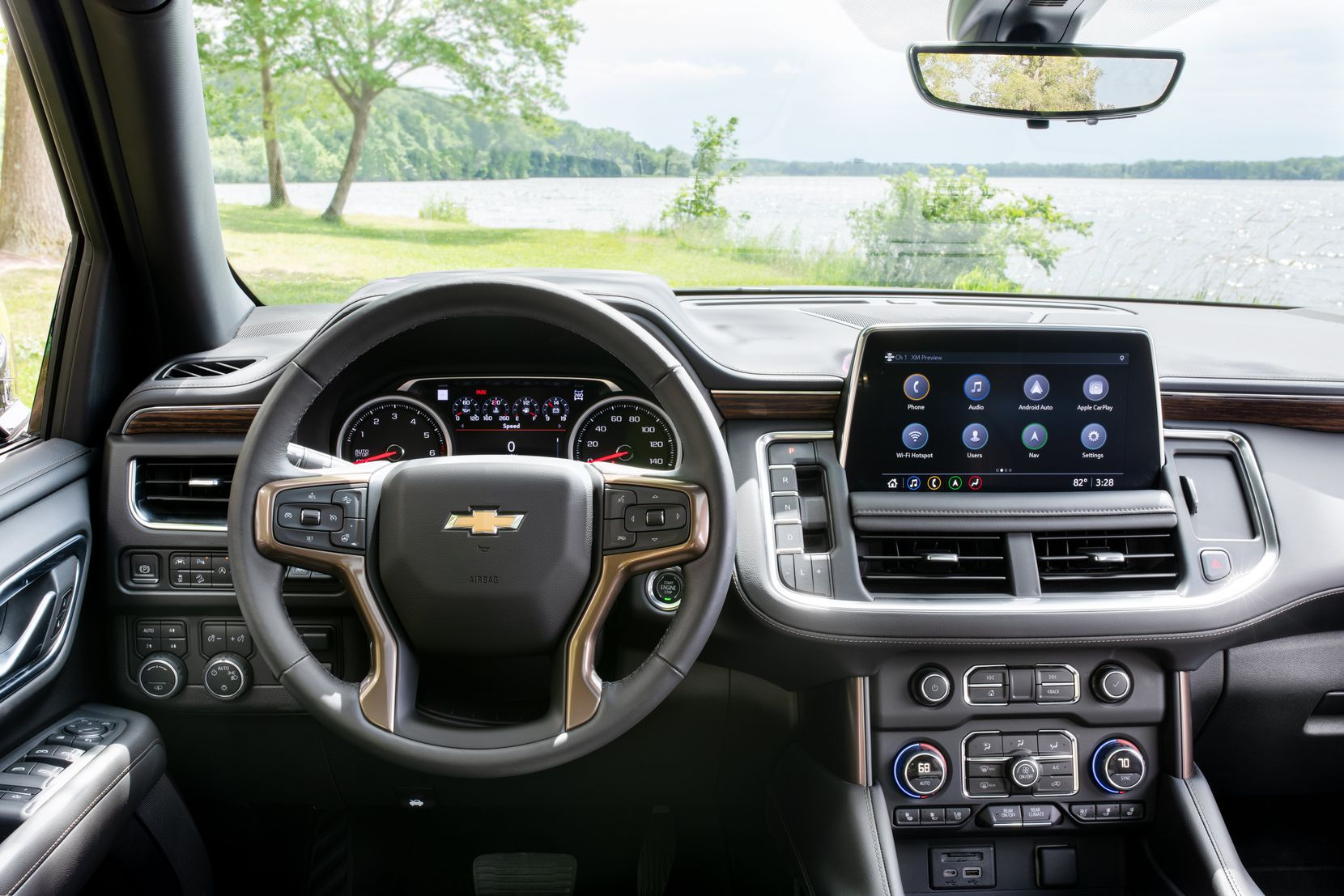 The Tahoe's interior has plenty of appealing features, including a panoramic sun roof and a motorized storage bin in the center console.
