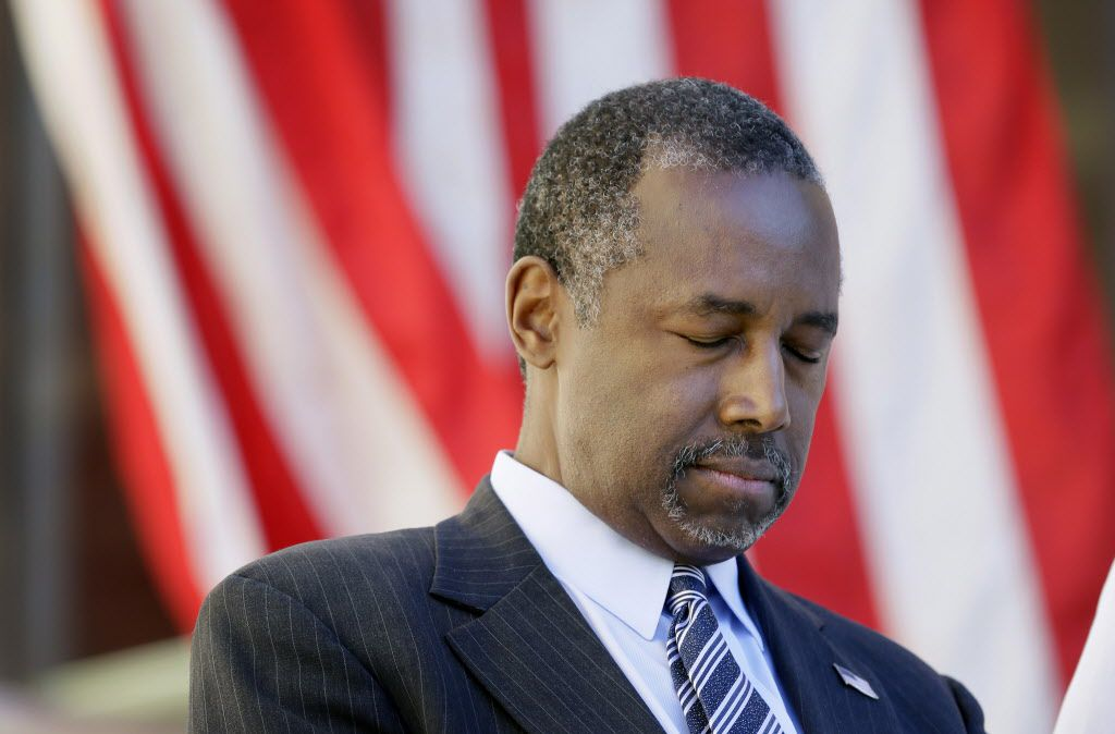 Republican presidential candidate Dr. Ben Carson bows his head in prayer before speaking at a town hall meeting, Friday, Oct. 2, 2015, in Ankeny, Iowa. (AP Photo/Charlie Neibergall)