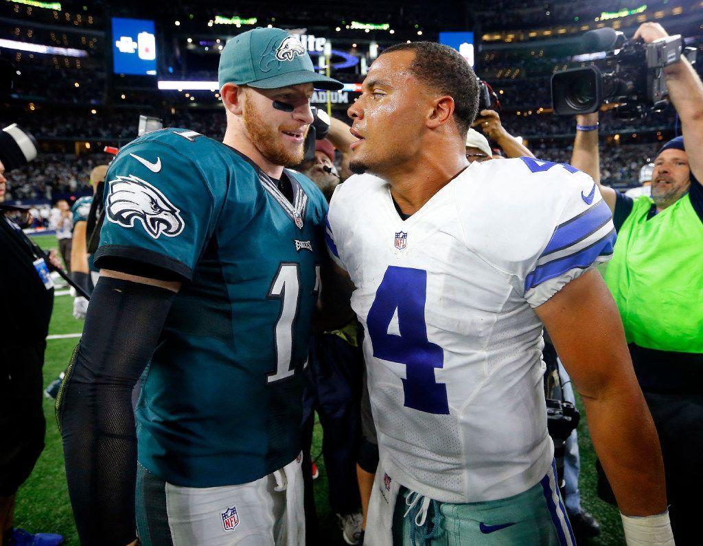 FILE - Philadelphia Eagles quarterback Carson Wentz (11) congratulates Dallas Cowboys quarterback Dak Prescott (4) after Dallas' 29-23 overtime win at AT&T Stadium in Arlington, Texas, Sunday, October 30, 2016. (Tom Fox/The Dallas Morning News)