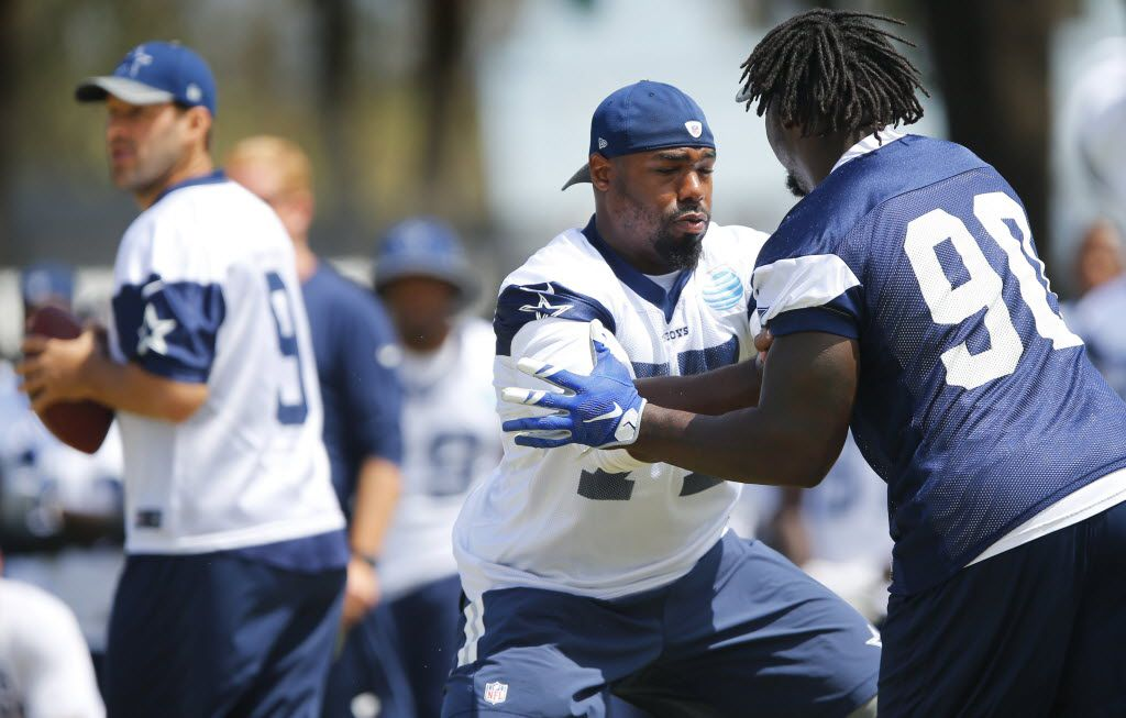 Dallas Cowboys tackle Tyron Smith (77) defends against defensive end Demarcus Lawrence (90) during morning walk-thru at training camp in Oxnard, California, Saturday, August 6, 2016. (Tom Fox/The Dallas Morning News)