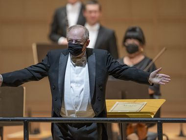Conductor Nicholas McGegan acknowledges the audience after conducting the Dallas Symphony Orchestra in Mozart's Concerto No, 20 and Symphony No. 40 at the Meyerson Symphony Center on Jan. 14.