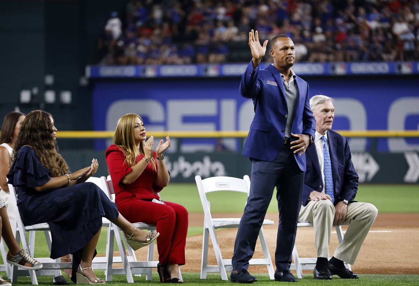 Former Texas Rangers third baseman Adrian Beltre (left) waves to fans after his Texas Rangers Baseball Hall of Fame induction speech at Globe Life Field in Arlington, Saturday, August 14, 2021. Executive vice president and public address announcer Chuck Morgan was also inducted. (Tom Fox/The Dallas Morning News)