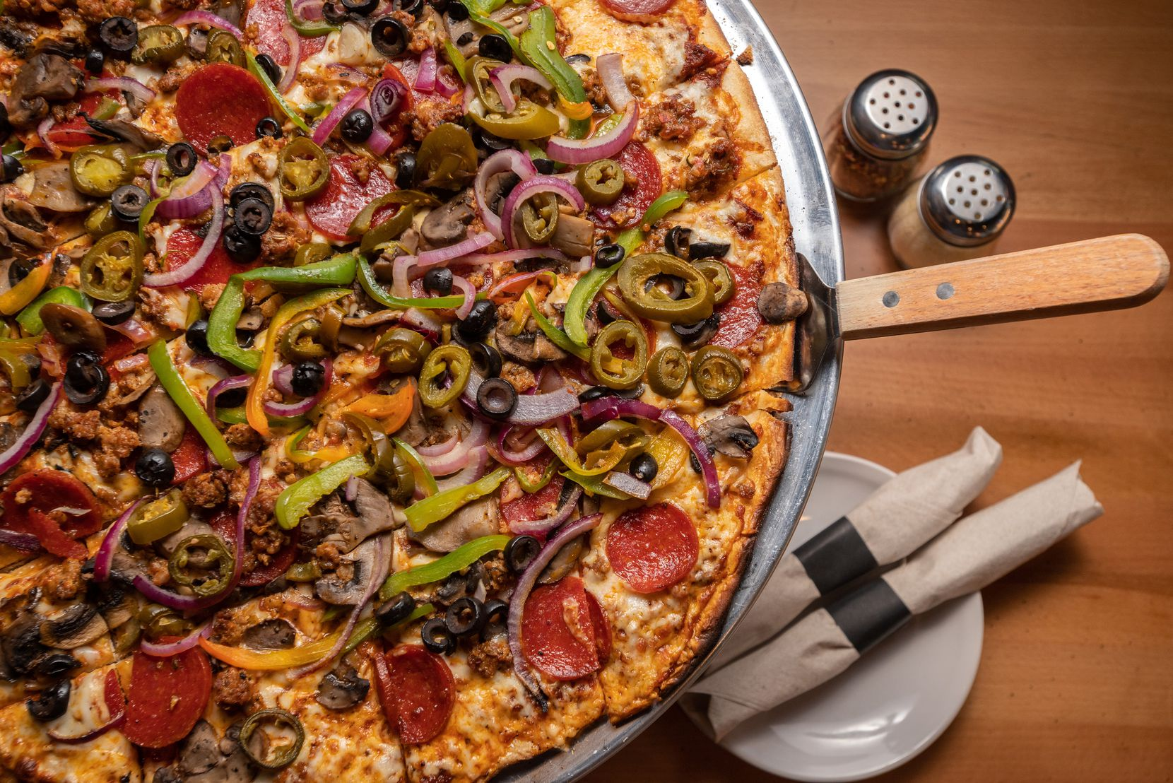 The SAT Deluxe pizza from Sylvan Avenue Tavern in West Dallas comes with marinara sauce, mozzarella, Jimmy's spicy sausage, pepperoni, black olives, green peppers, red onions, mushrooms and jalapeños.