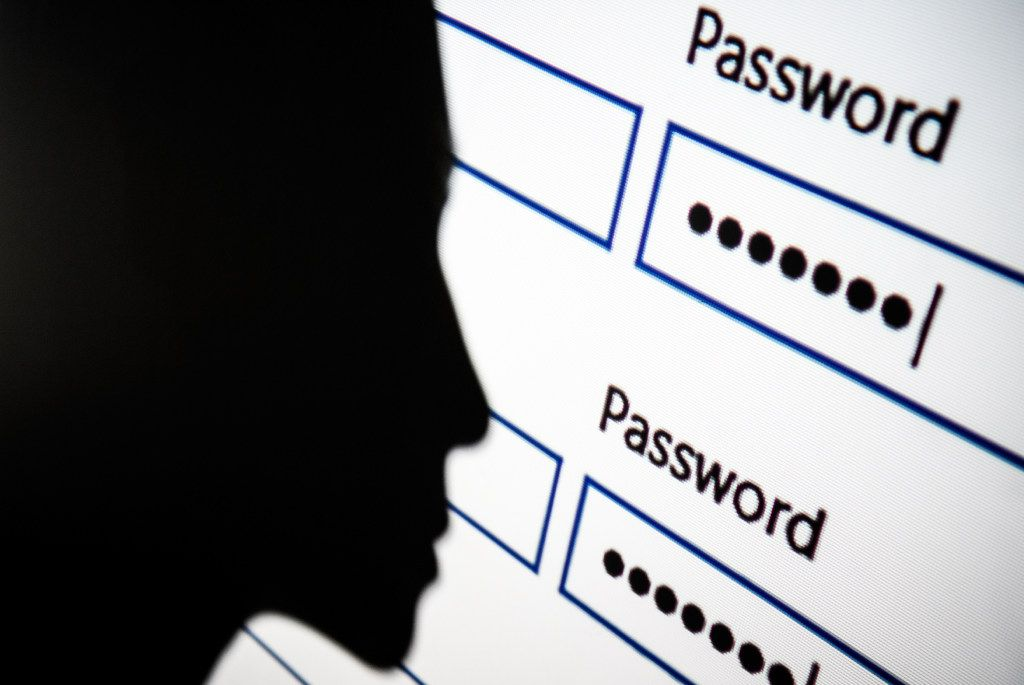 In this photo illustration, A woman is silhouetted against a projection of a password log-in dialog box on August 09, 2017 in London, England.  (Photo by Leon Neal/Getty Images)