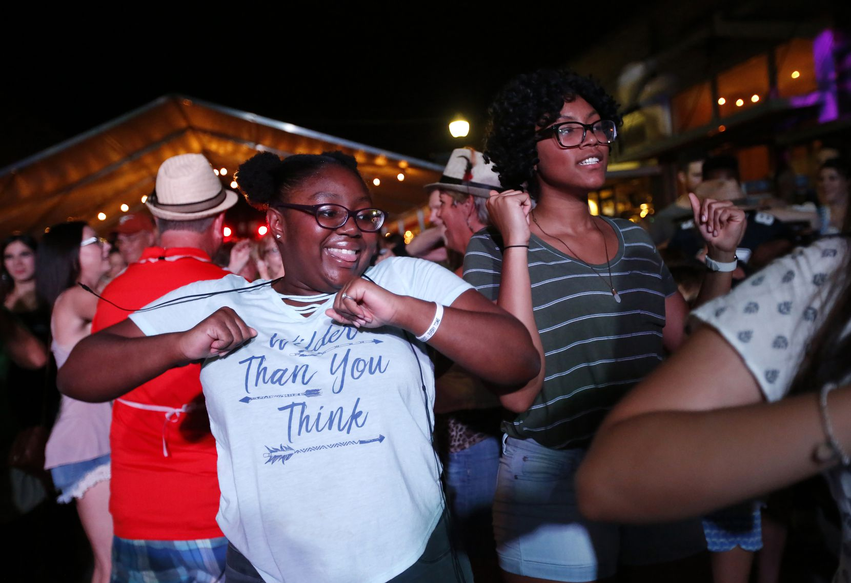 Kihya Houston, left, and Zoe Trask do the chicken dance during the 2017 McKinney Oktoberfest. The 2021 event will be held Sept. 24-26.