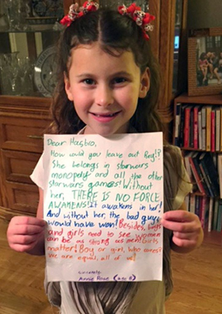 """In this January 2016 photo provided by Carrie Goldman, her daughter, Annie Rose, holds a letter in Evanston, Ill., that she wrote to Hasbro asking why the female character Rey was omitted from a Monopoly set based on """"Star Wars: The Force Awakens,"""" when she is a main character and crucial to the story."""