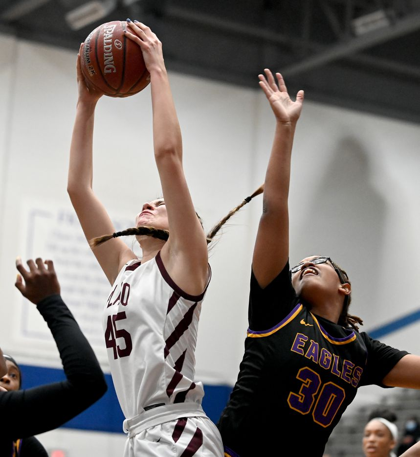 Plano's Avery Foltz (45) grabs a rebound over Richardson's Amya Patterson in the first half of a Class 6A girls high school playoff basketball game between Plano vs.  Richardson, Monday, Feb. 22, 2020, in Carrollton, Texas. (Matt Strasen/Special Contributor)
