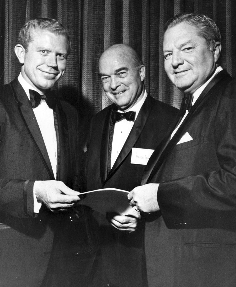 September 7, 1969 - LAND TRANSFERRED TO UTD - Texas Lt. Governor Ben Barnes (left) and Frank Erwin (right), chairman of the University of Texas System Board of Regents, accept land transfer documents from Dallas Mayor J. Erik Jonsson, one of the founders of the Southwest Center for Advanced Studies, which now become the University of Texas at Dallas.
