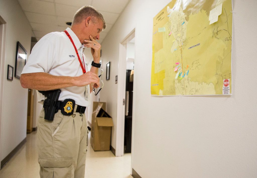 Fire Chief Jeff McNeal looks at a map of the area surrounding Lumberton, Texas as Hurricane Harvey hit landfall for a second time on Tuesday, August 29, 2017 at Central Fire Station in Lumberton, Texas. (Ashley Landis/The Dallas Morning News)