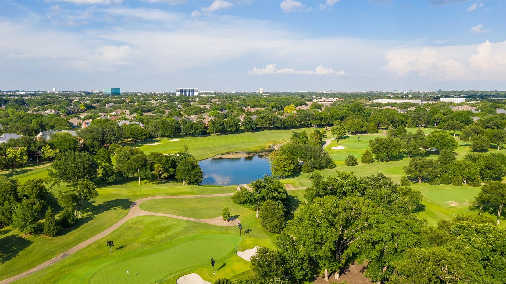 The half-acre home at 5403 Preston Fairways Circle in Dallas offers golf course views and 4,707 square feet of living space.
