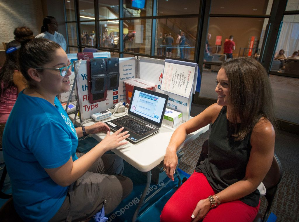 Sandy Gamez, left, chats with Brooke Bryant, associate pastor at Gateway Church in Southlake during a blood drive at the church, The church's senior pastor, Robert Morris, credits the seven units of blood he received to saving his life.