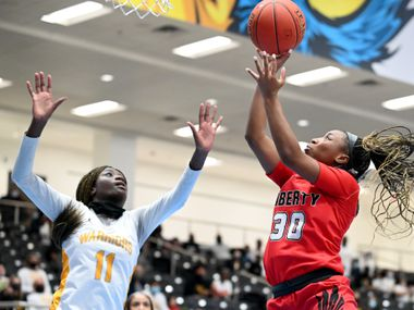 Liberty's Jazzy Owens-Barnett (30) shoots over Liberty's Falyn Lott (11) in the second half of a Class 5A girls high school playoff basketball game between Frisco Memorial and Frisco Liberty, Wednesday, Feb. 24, 2021, in Frisco, Texas.