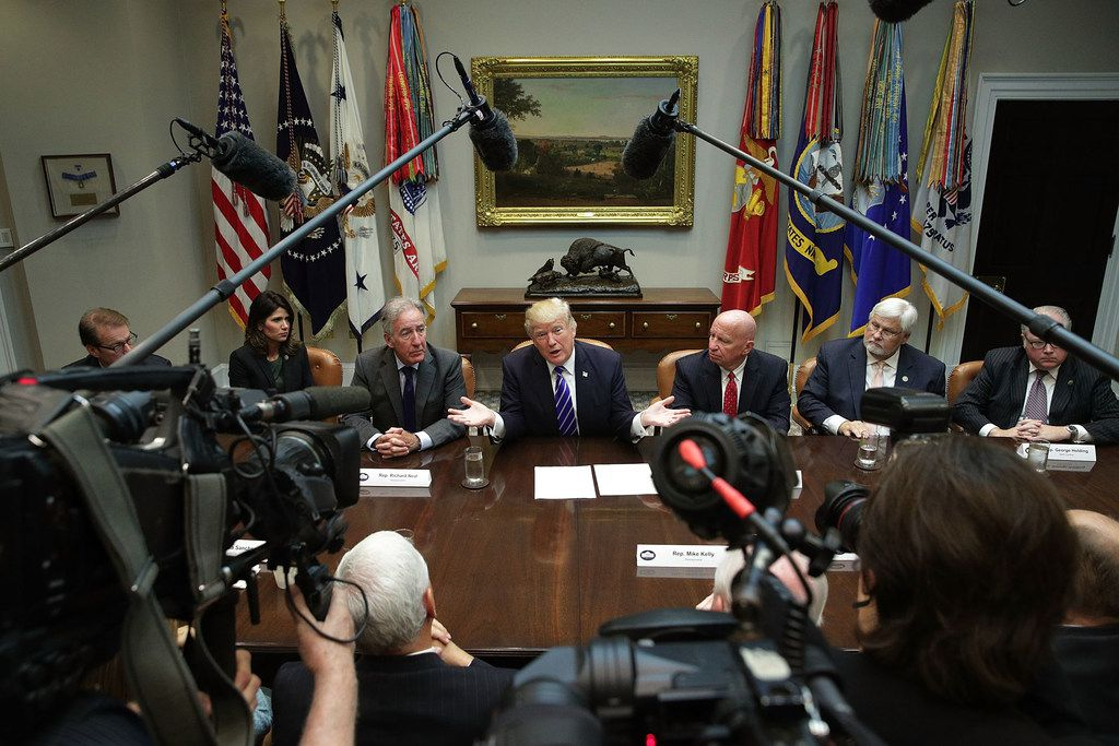 President Donald Trump speaks during a meeting with members of the House Ways and Means Committee as committee chairman Rep. Kevin Brady (right of Trump), R-Texas, and ranking member Rep. Richard Neal (left of Trump), D-Mass., listen Sept. 26, 2017.