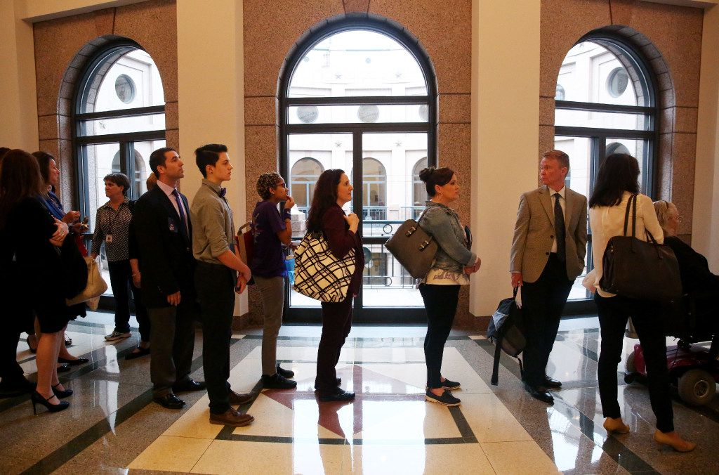 People waited in the sign-up line to give a testimony as members of the Senate State Affairs Committee debated and heard public testimony of Senate Bill 6, the transgender bathroom bill, at the Texas State Capitol in Austin on March 7.  (Rose Baca/The Dallas Morning News)