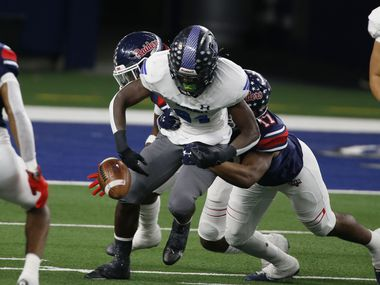 Mansfield Summit's Desmond Walton (84) fumbles the football, after being hit by Ryan's Michael Gee (17). The ball was scooped up by Denton Ryan defender Ty Marsh (4) and advanced for a touchdown during the first half of the Class 5A Division I state semifinal football playoff game at AT&T Stadium in Arlington on Friday, January 8, 2021.