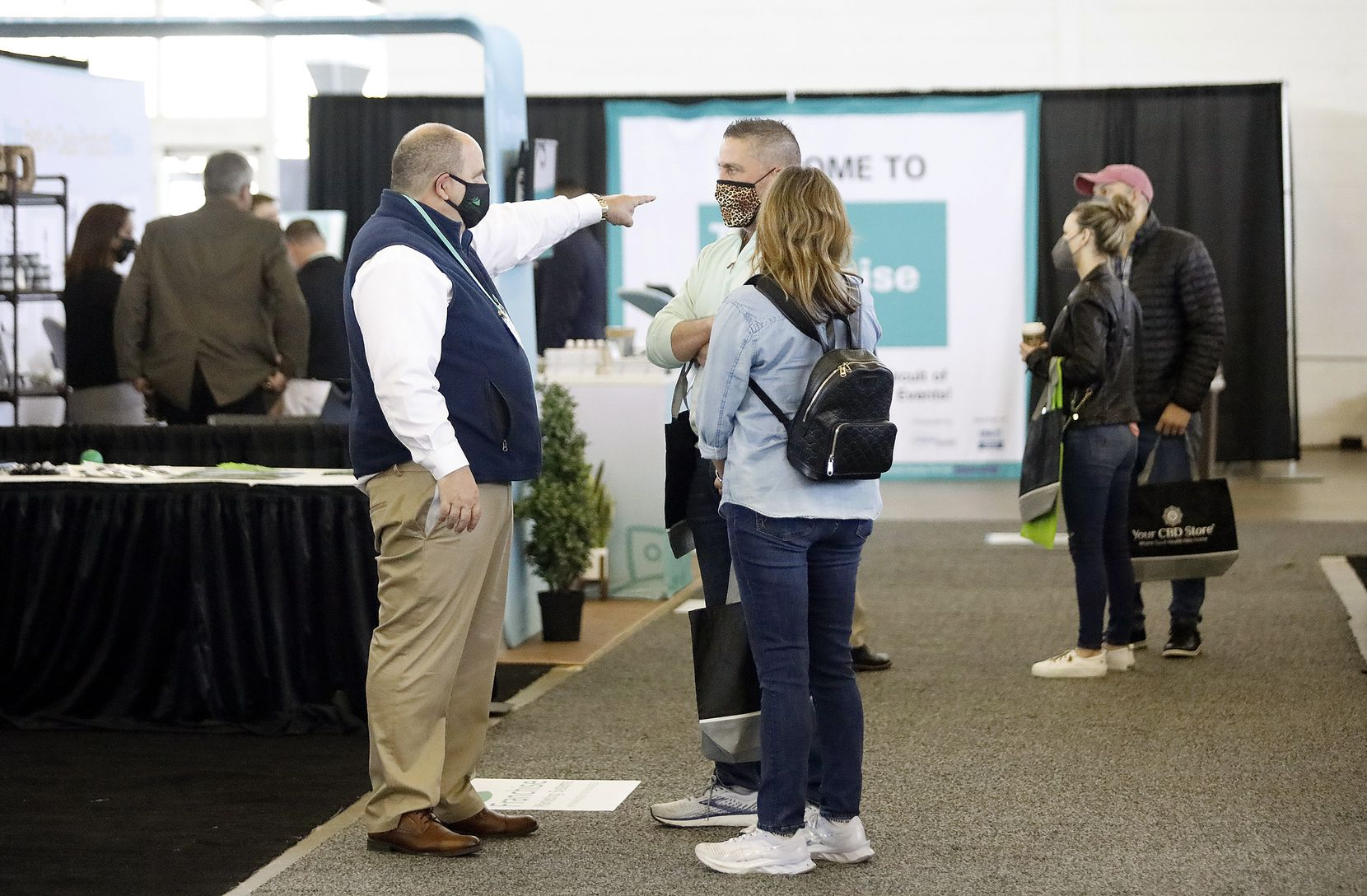 Patrons visit the different booths at The Franchise Show, a conference for local entrepeneurs interested in starting their own franchise business in North Texas at the Dallas Market Hall in Dallas on Saturday, March 20, 2021.  (Stewart F. House/Special Contributor)