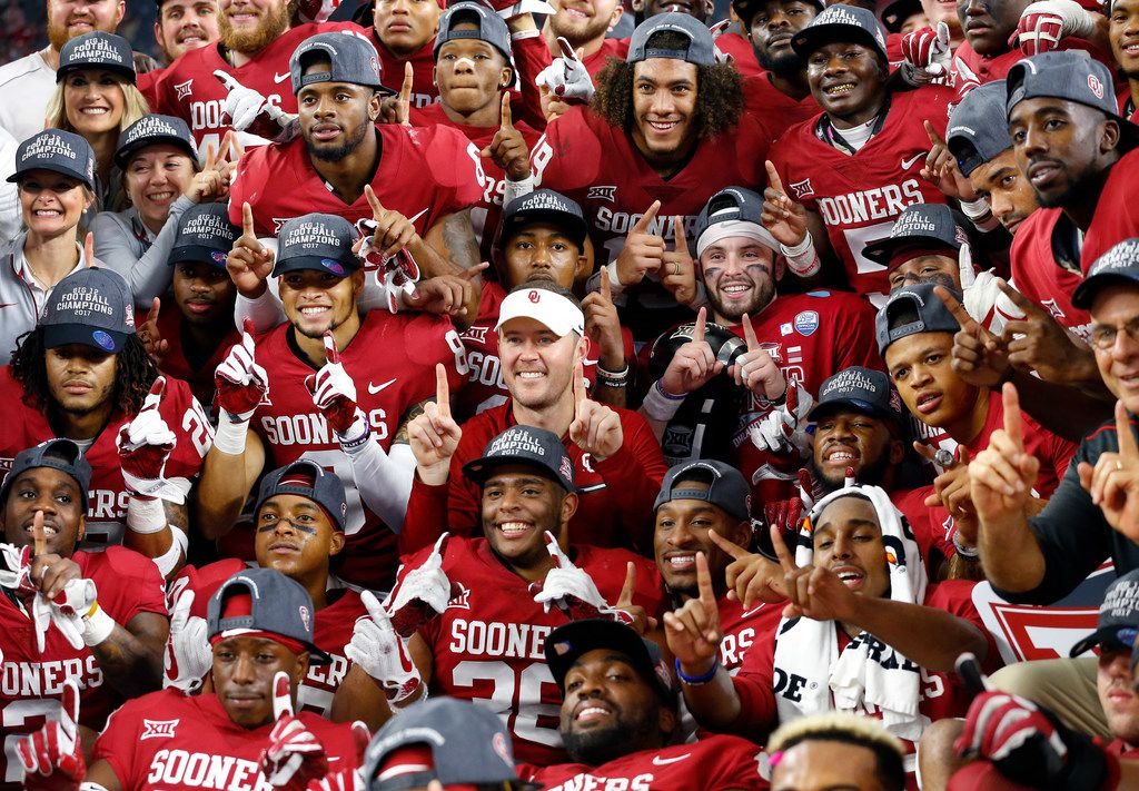 The Oklahoma Sooners football team, including head coach Lincoln Riley (center) and quarterback Baker Mayfield (to his left) pose for a Big XII Championship winning photo after defeating the TCU Horned Frogs at AT&T Stadium in Arlington, Texas, Saturday, December 2, 2017. The Sooners won, 41-17. (Tom Fox/The Dallas Morning News)