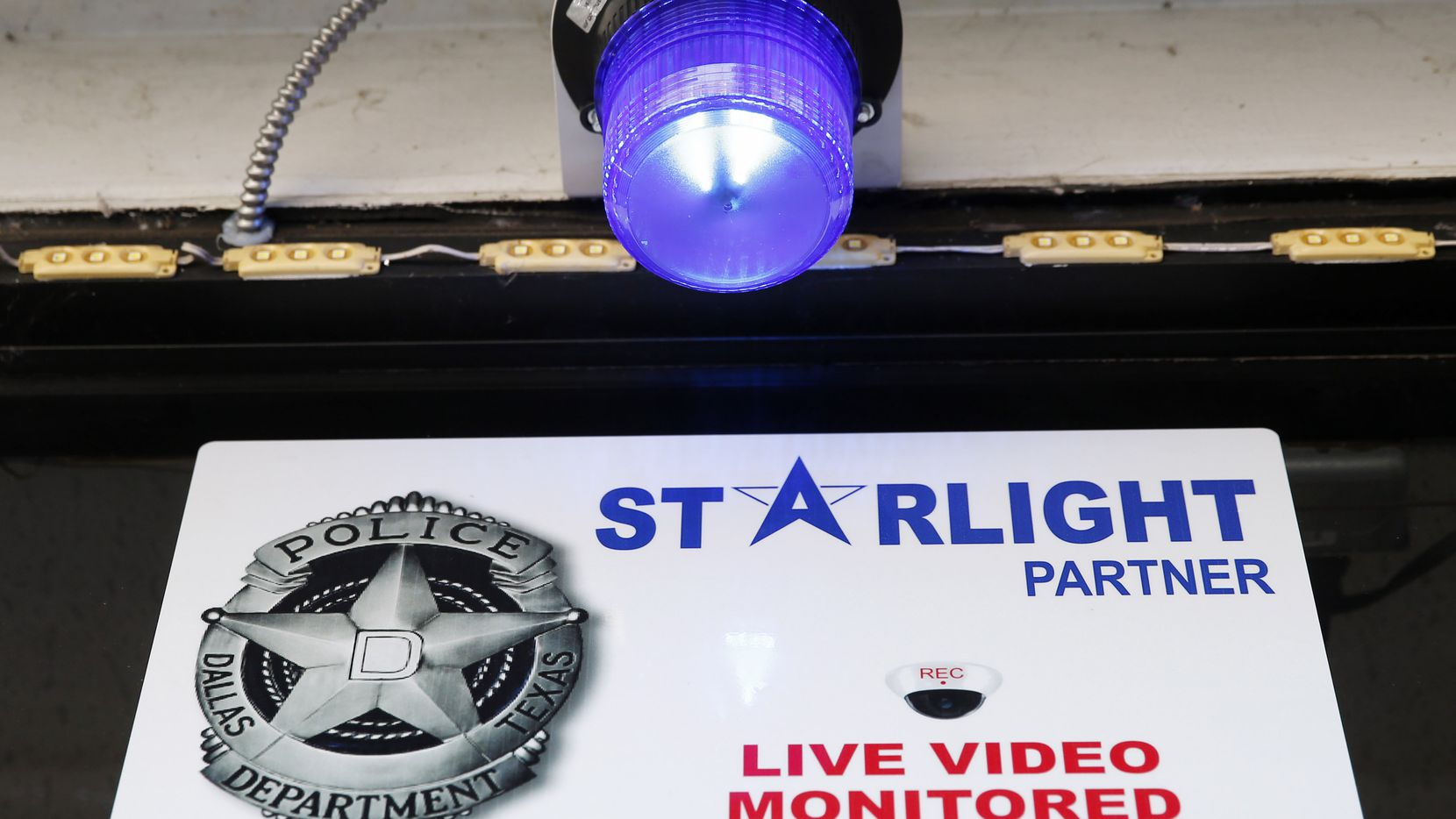 The blue light and signage in front of Ferguson Food Mart that marks the business as part of the Starlight program in Dallas on Monday, November 4, 2019. Starlight is a DPD crime initiative that will allow DPD to use video cameras that recognize anomalies that might indicate a crime in progress at a location. (Vernon Bryant/The Dallas Morning News)