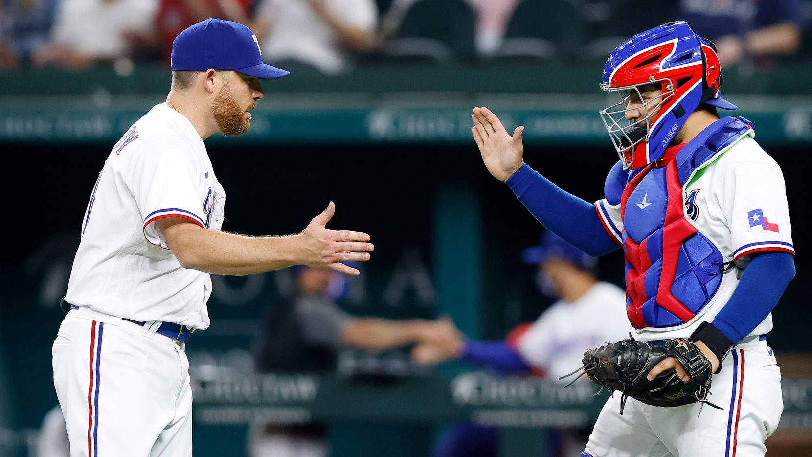 Texas Rangers relief pitcher Ian Kennedy (31) is congratulated by catcher Jose Trevino (23) after striking out the final Boston Red Sox batter in the ninth inning at Globe Life Field in Arlington, Texas, Thursday, April 29, 2021.