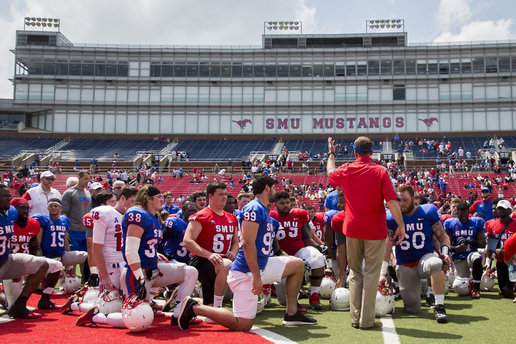 SMU players gather around SMU head coach Chad Morris after the team's spring football game at Ford Stadium on Saturday, April 16, 2016, in Dallas. (Smiley N. Pool/The Dallas Morning News)