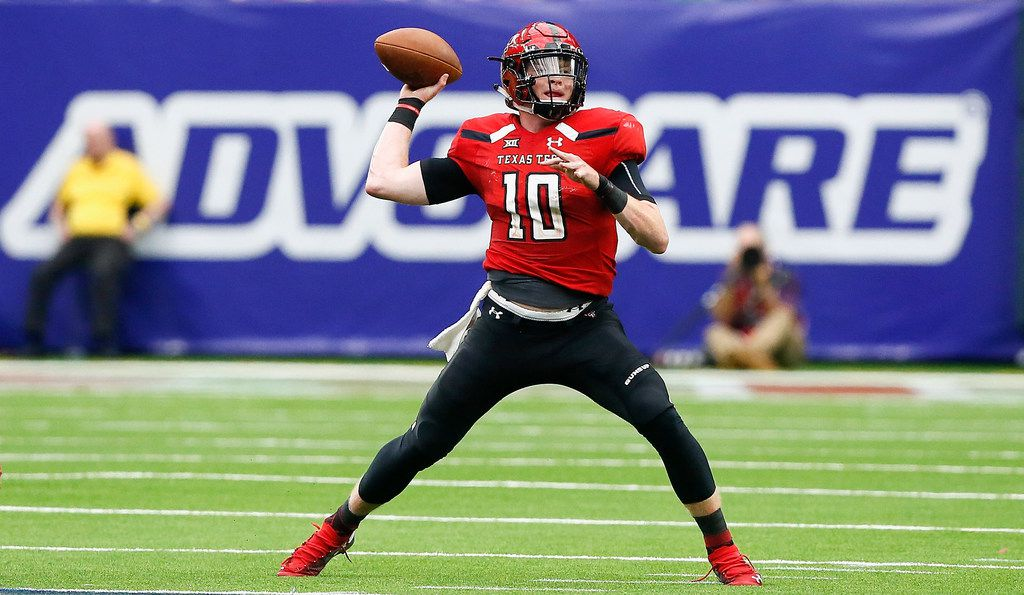 HOUSTON, TX - SEPTEMBER 01:  Alan Bowman #10 of the Texas Tech Red Raiders throws a pass in the third quarter against the Mississippi Rebels at NRG Stadium on September 1, 2018 in Houston, Texas.  (Photo by Bob Levey/Getty Images)