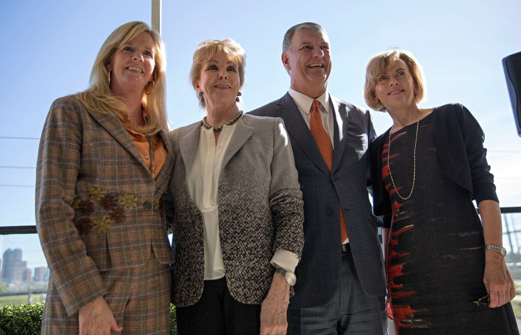 (From left) Amy Simmons, Annette Simmons, Dallas Mayor Mike Rawlings and Lisa Simmons pose for photographs following a press conference to announce the donation of $50 million by the Simmons family to the City of Dallas Monday, October 31, 2016 in Dallas. The money will help fund a large, urban park planned for the Trinity River levee area near downtown Dallas. (G.J. McCarthy/The Dallas Morning News)