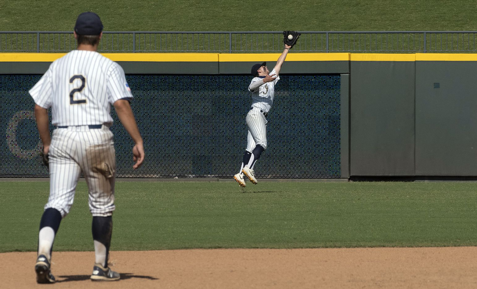 Keller Clayton Thomas, (7), runs down a fly ball hit by Houston Strake Jesuit Jacob Dorman, (7), during the fourth inning of the 2021 UIL 6A state baseball semifinals held, Friday, June 11, 2021, in Round Rock, Texas.  Keller defeated Strake Jesuit 7-1.  (Rodolfo Gonzalez/Special Contributor)
