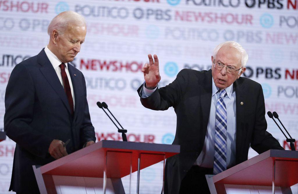 Democratic presidential candidate Sen. Bernie Sanders, I-Vt., right, speaks as former Vice President Joe Biden listens during a Democratic presidential primary debate Thursday, Dec. 19, 2019, in Los Angeles. (AP Photo/Chris Carlson)