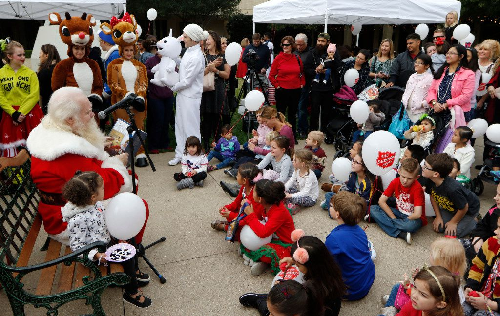 Santa Claus played by Carl Anderson, reads Rudolph the Red-Nosed Reindeer story during the 2016 Angel Tree Extravaganza for The Salvation Army Angel Tree at NorthPark Center on Black Friday, November 25, 2016 in Dallas, Texas. (David Woo/The Dallas Morning News)