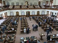 """Texas legislators are choosing sides and assessing the """"monumental"""" impact of the University of Texas' potential move of its athletics program to the Southeastern Conference. In July 14 photo, GOP House members mill about the chamber after Democratic members fled the state to protest an """"election security"""" bill."""
