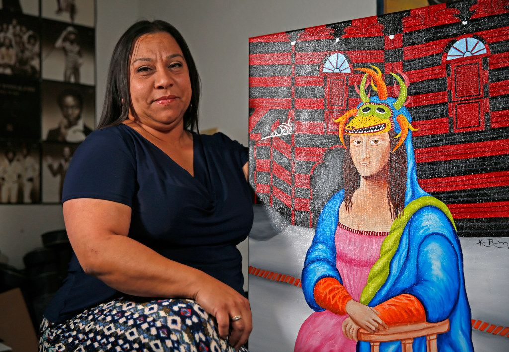 Artist Katherine Rodriguez, with one of her paintings at Sara Rosado's home in Arlington, left her home in the island territory of Puerto Rico 25 years ago.
